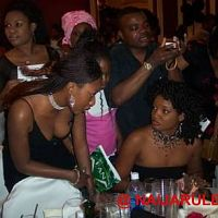Fans getting autograph from Omotola
