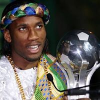 Drogba with his award