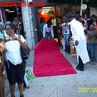 Setting up the red carpet while an expectant crowd waits